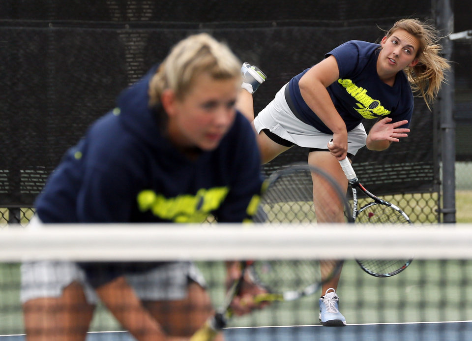 Southmoore's Jordan Henry serves as her partner, Lexie Klingler, waits in a Class 6A #1 Doubles match during the girls high school state tennis tournament at the Oklahoma City Tennis Center in Oklahoma City,  Saturday, May 4, 2013. Photo by Nate Billings, The Oklahoman