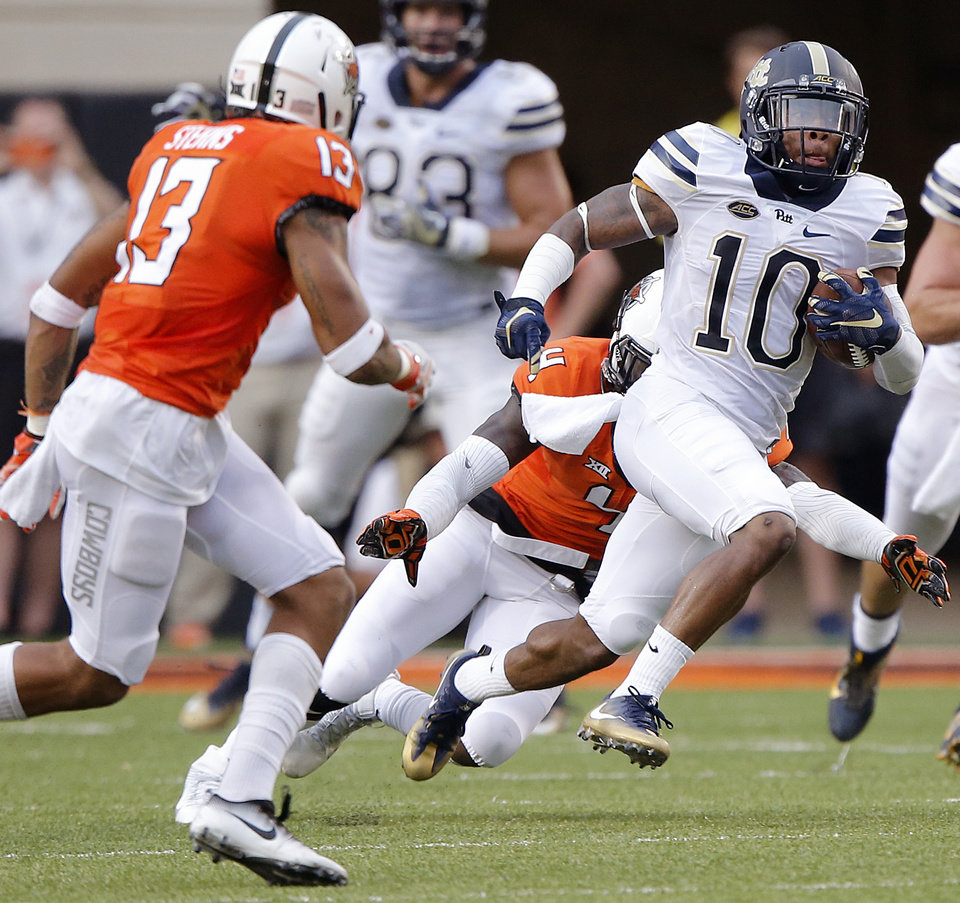 Photo - Pittsburgh's Quadree Henderson (10) runs past Oklahoma State's Lenzy Pipkins (4) and Jordan Sterns (13) during a college football game between the Oklahoma State Cowboys (OSU) and the Pitt Panthers at Boone Pickens Stadium in Stillwater, Okla., Saturday, Sept. 17, 2016. Photo by Chris Landsberger, The Oklahoman