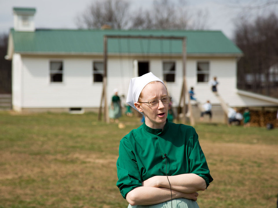 HOLD FOR STORY Emma Miller answers questions during an interview in Bergholz, Ohio on Tuesday, April 9, 2013.  Miller was convicted and sentenced to prions for her role in the hair and beard cutting scandal against other Amish members.  (AP Photo/Scott R. Galvin)