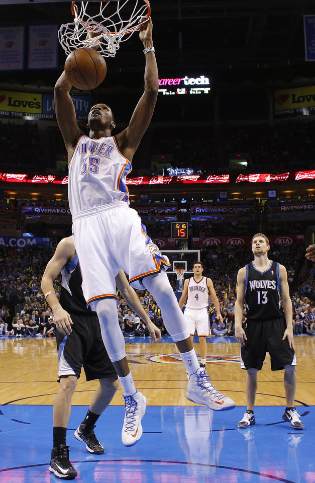 Photo - Oklahoma City's Kevin Durant (35) dunks the ball during an NBA basketball game between the Oklahoma City Thunder and the Minnesota Timberwolves at Chesapeake Energy Arena in Oklahoma City, Wednesday, Jan. 9, 2013.  Oklahoma City won 106-84. Photo by Bryan Terry, The Oklahoman