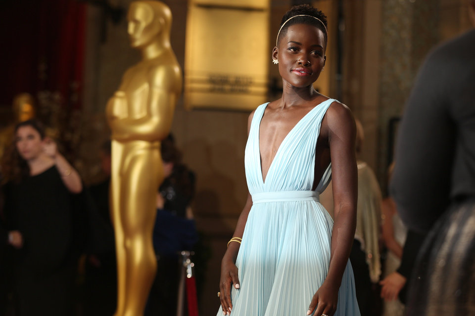 Photo - Lupita Nyong'o arrives at the Oscars on Sunday, March 2, 2014, at the Dolby Theatre in Los Angeles.  (Photo by Matt Sayles/Invision/AP)