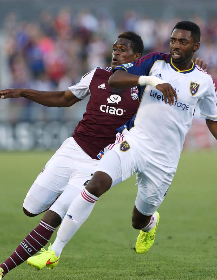 Photo - Real Salt Lake defenseman Aaron Maund, right, blocks Colorado Rapids forward Deshorn Brown as they compete for control of ball in the first half of an MLS soccer game in Commerce City, Colo., on Saturday, Aug. 2, 2014. (AP Photo/David Zalubowski)