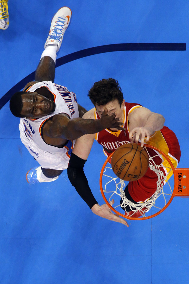 Photo - Houston's Omer Asik (3) dunks as Oklahoma City's Kendrick Perkins (5) defends during Game 5  in the first round of the NBA playoffs between the Oklahoma City Thunder and the Houston Rockets at Chesapeake Energy Arena in Oklahoma City, Wednesday, May 1, 2013. Photo by Sarah Phipps, The Oklahoman