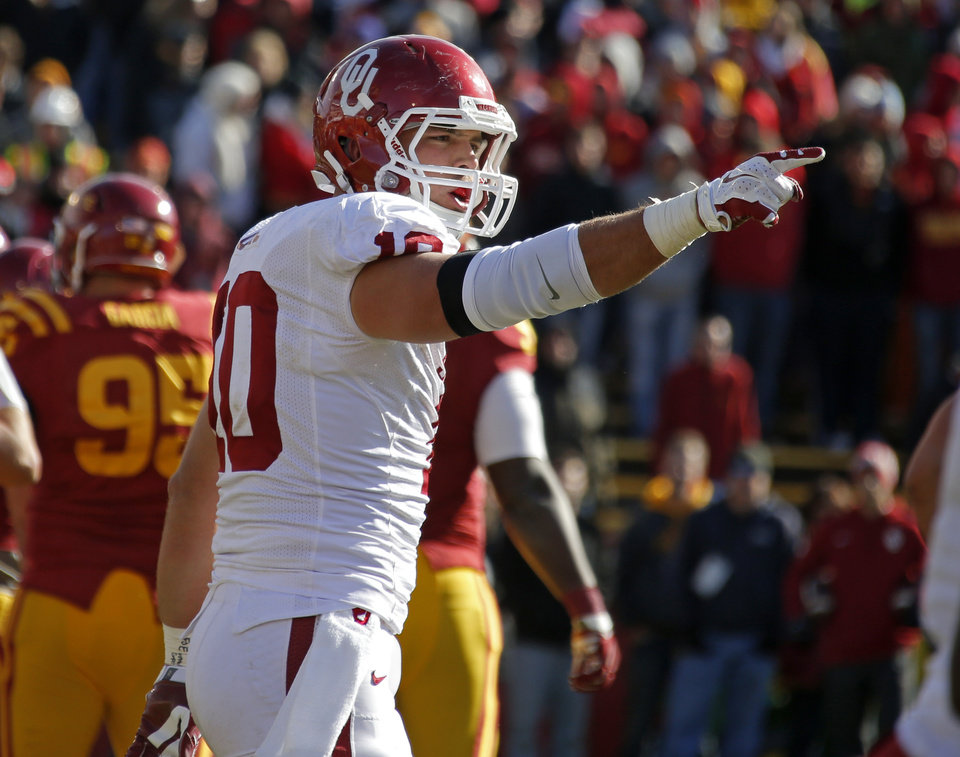 Photo - Oklahoma's Blake Bell (10) celebrates after a touchdown during a college football game between the University of Oklahoma Sooners (OU) and the Iowa State Cyclones (ISU) at Jack Trice Stadium in Ames, Iowa, Saturday, Nov. 1, 2014. Photo by Bryan Terry, The Oklahoman
