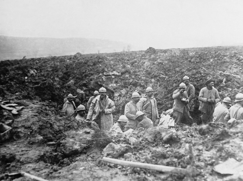 Photo - FILE - In this October 1917 file photo, French troops in a shell hole during the offensive which resulted in its winning back of the Chemin des Dames in France at the end of October 1917. One hundred years after the war began, Tour de France organizers have decided to mark the anniversary with a series of stages across the northern and eastern French and Belgian battlefields where so many lives were lost. (AP Photo, File)