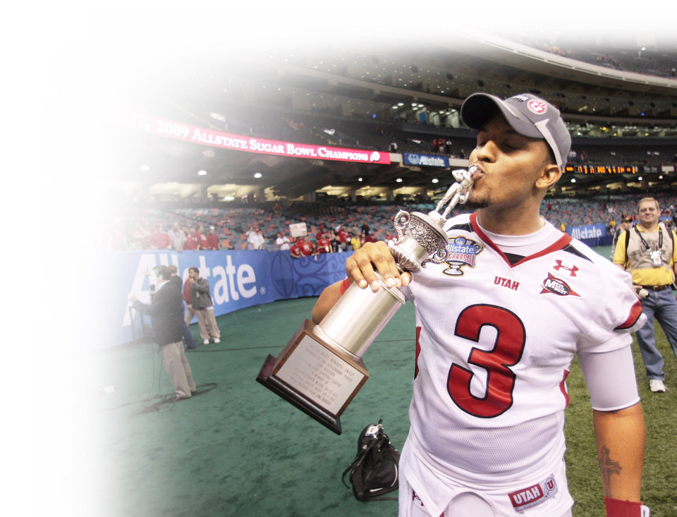 Photo - Utah quarterback Brian Johnson kisses his Sugar Bowl MVP trophy. The Utes didn't get a chance to play for the national championship despite being undefeated.   AP Photo
