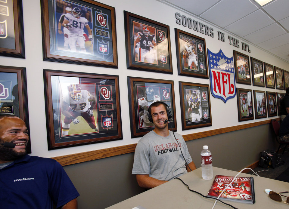 Photo - Sooner quarterback Landry Jones does a radio interview in the hallway of NFL Sooners during the media event at the University of Oklahoma on Saturday, Aug. 4, 2012, in Norman, Okla.  Photo by Steve Sisney, The Oklahoman