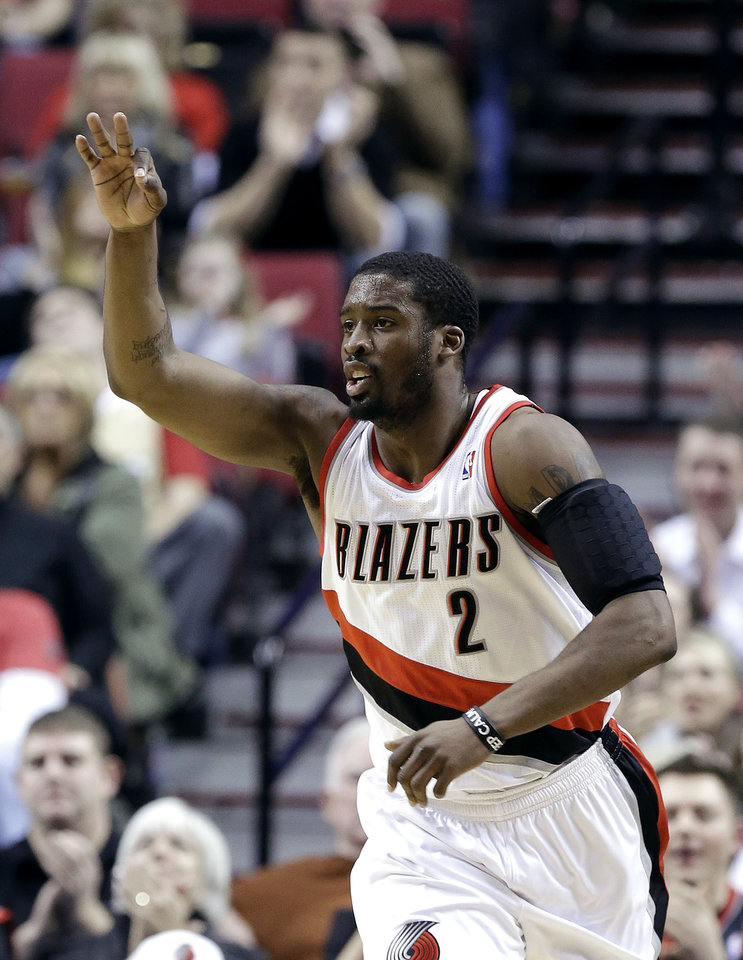 Photo - Portland Trail Blazers guard Wesley Matthews celebrates sinks a 3-point shot during the first quarter of an NBA basketball game against the Washington Wizards in Portland, Ore., Monday, Jan. 21, 2013. (AP Photo/Don Ryan)