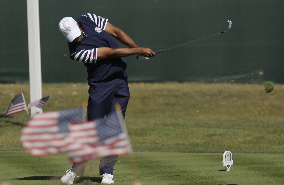 USA's Tiger Woods hits a drive on the second hole during a singles match at the Ryder Cup PGA golf tournament Sunday, Sept. 30, 2012, at the Medinah Country Club in Medinah, Ill. (AP Photo/Charles Rex Arbogast)  ORG XMIT: PGA139