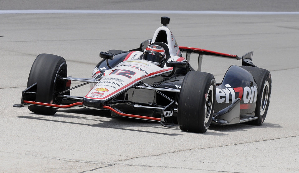 Photo - Will Power of Australia pulls onto pitt row after taking the pole position during qualifying for the IndyCar auto race at Texas Motor Speedway in Fort Worth, Friday, June 6, 2014. (AP Photo/Larry Papke)
