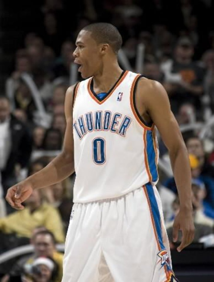 Photo - Oklahoma City's  Russell  Westbrook (0) celebrates a Thunder score during the NBA game between the Oklahoma City Thunder and Cleveland Cavaliers, Sunday, Dec. 21, 2008, at the Ford Center in Oklahoma City. PHOTO BY SARAH PHIPPS