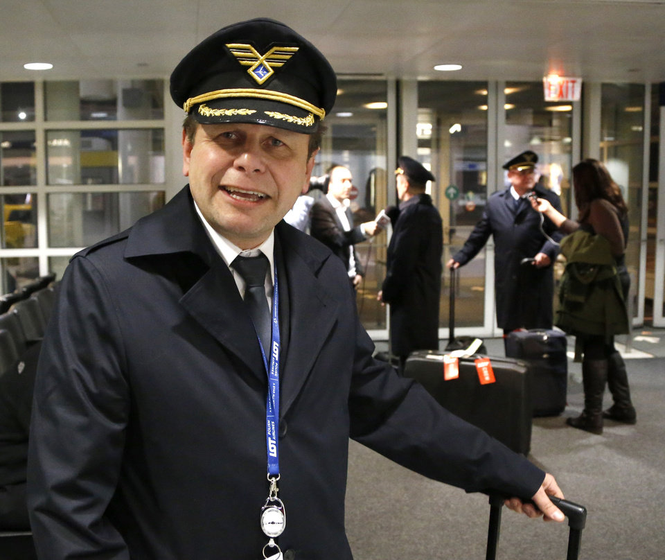Photo - Polish Airlines Captain Stanislaw Radzio talks about the flight of LOT flight 003 from Warsaw, a Boeing 787, after their arrival at Chicago's O'Hare International Airport Wednesday, Jan. 16, 2013. The FAA grounded all Boeing 787 Dreamliner airplanes pending safety checks of the planes lithium batteries and passengers ticketed on the return flight to Warsaw were rebooked on other airlines. (AP Photo/Charles Rex Arbogast)