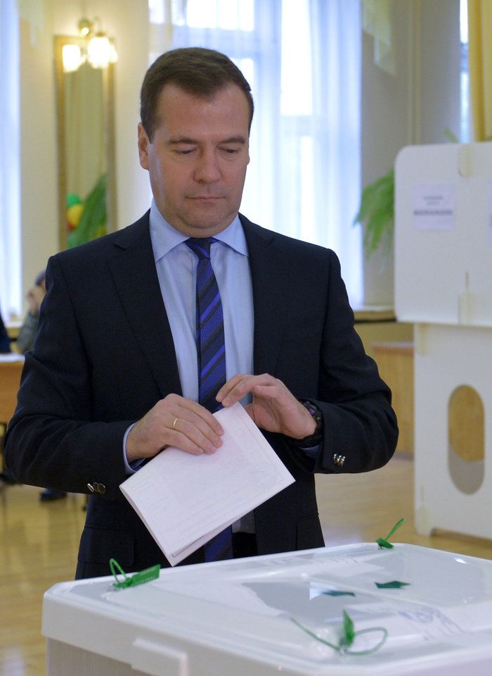 Photo - Russian Prime Minister, Dmitry Medvedev, casts his ballot at a polling station in Moscow, Russia, Sunday, Sept. 8, 2013. Moscow is holding its first mayoral election in a decade. Although an incumbent backed by President Vladimir Putin is expected to win Sunday's election handily, the candidacy of charismatic opposition leader Alexei Navalny is changing Russian politics in ways that could pose a risk for the Kremlin in the months and years ahead. (AP Photo/RIA-Novosti, Alexander Astafyev, Government Press Service)