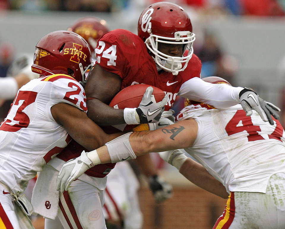 Oklahoma's Dejuan Miller (24) tries to get past Iowa State's Leonard Johnson (23) and A.J. Klein during a college football game between the University of Oklahoma Sooners (OU) and the Iowa State University Cyclones (ISU) at Gaylord Family-Oklahoma Memorial Stadium in Norman, Okla., Saturday, Nov. 26, 2011. Photo by Bryan Terry, The Oklahoman