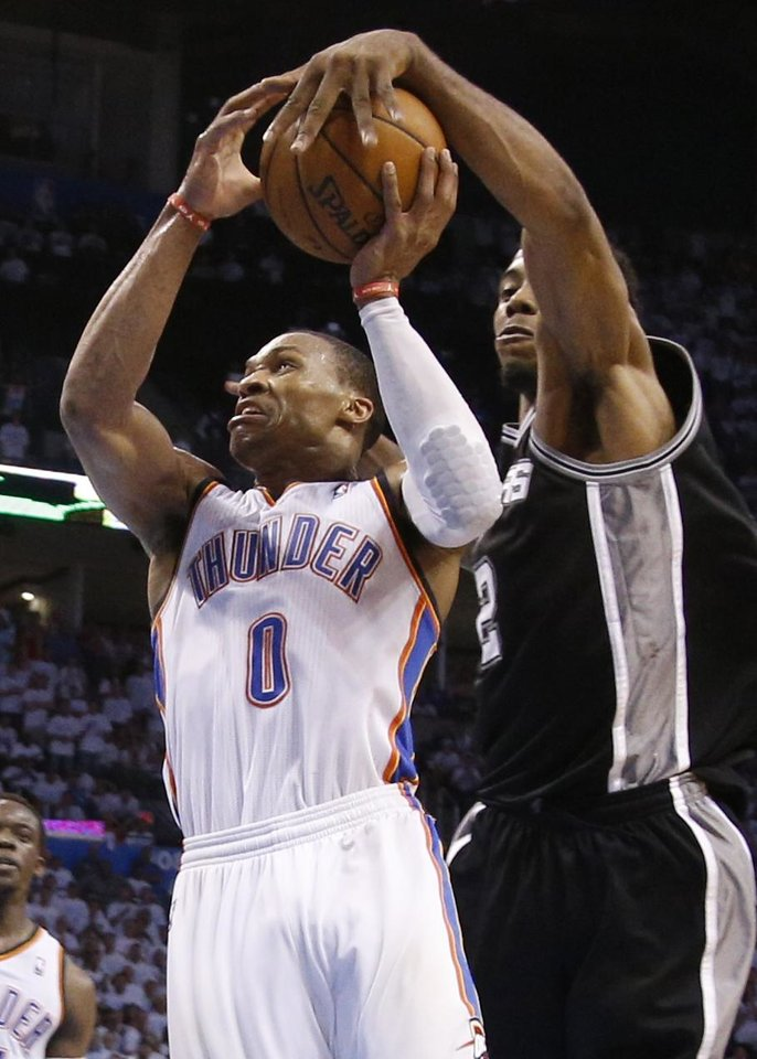 Photo - Oklahoma City's Russell Westbrook (0) has his shot blocked by San Antonio's Kawhi Leonard (2) late in overtime of Game 6 of the Western Conference Finals in the NBA playoffs between the Oklahoma City Thunder and the San Antonio Spurs at Chesapeake Energy Arena in Oklahoma City, Saturday, May 31, 2014. Oklahoma City lost 112-107. Photo by Bryan Terry, The Oklahoman