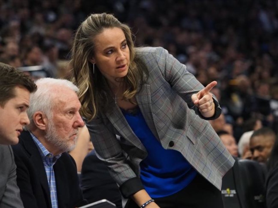 Photo -  Becky Hammon, talking with San Antonio head coach Gregg Popovich during a game in Sacramento this past season, has been a Spurs assistant since 2014. She has been a candidate for several NBA head coaching jobs, but the Spurs-Thunder connections might put her on Oklahoma City's short list. [KELLEY L COX/USA TODAY SPORTS]
