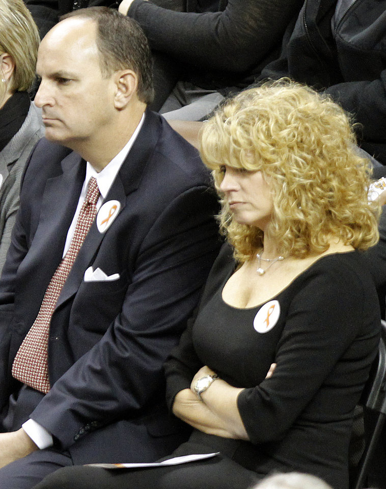 Photo - University of Oklahoma (OU) athletic director Joe Castiglione and women's basketball coach Sherri Cole attend the memorial service for Oklahoma State head basketball coach Kurt Budke and assistant coach Miranda Serna at Gallagher-Iba Arena on Monday, Nov. 21, 2011 in Stillwater, Okla. The two were killed in a plane crash along with former state senator Olin Branstetter and his wife Paula while on a recruiting trip in central Arkansas last Thursday. Photo by Chris Landsberger, The Oklahoman