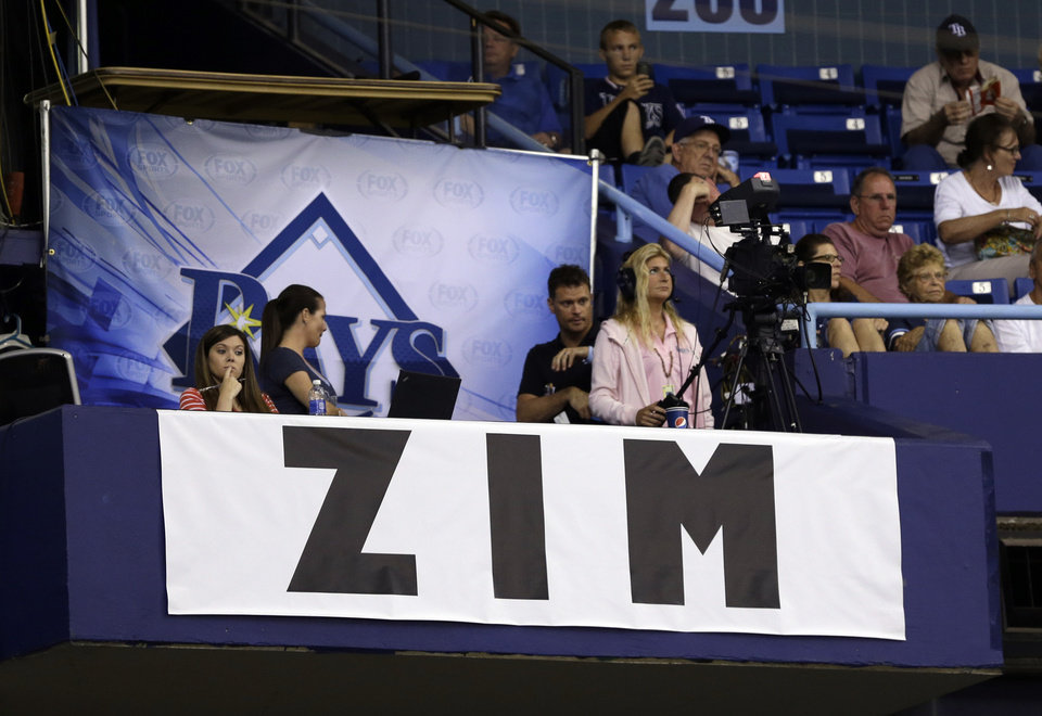 Photo - A banner honoring Tampa Bay Rays senior baseball advisor Don Zimmer hangs inside Tropicana Field during the fifth inning of an interleague baseball game between the Rays and the Miami Marlins Wednesday, June 4, 2014, in St. Petersburg, Fla. Zimmer passed away today. He was 83. (AP Photo/Chris O'Meara)