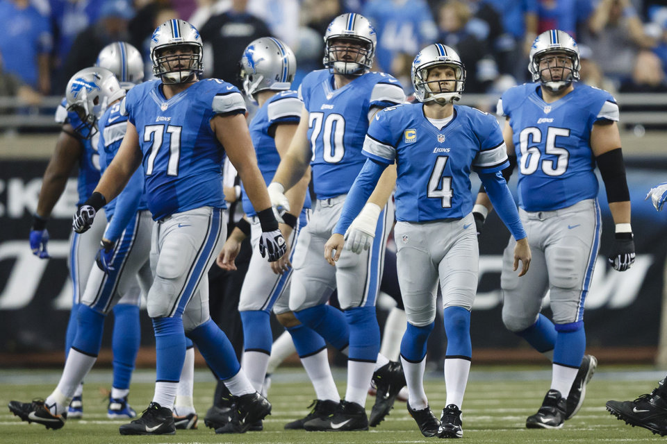 Detroit Lions kicker Jason Hanson (4), offensive tackle Riley Reiff (71), tackle Jason Fox (70) and guard Dylan Gandy (65) walk off the field after Hanson missed the potential game-winning field goal against the Houston Texans in overtime of an NFL football game at Ford Field in Detroit, Thursday, Nov. 22, 2012. The Texans won 34-31. (AP Photo/Rick Osentoski)