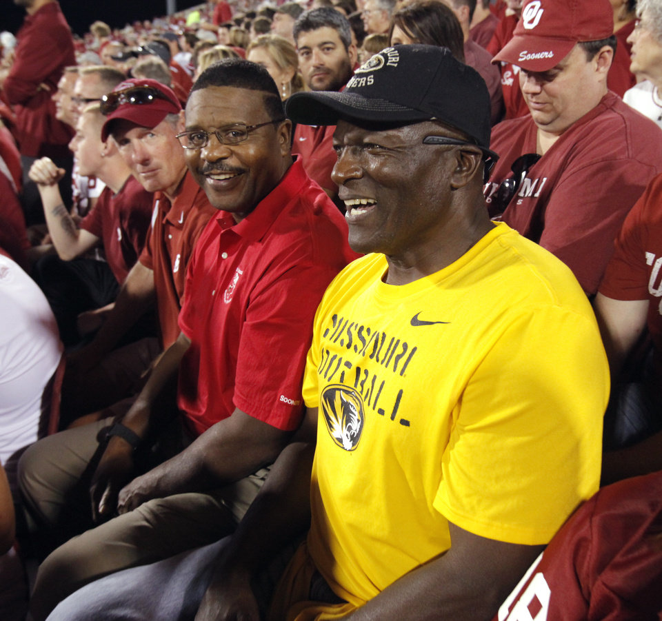 Willie Franklin watches his son, Missouri quarterback James Franklin, during the second half of the game Saturday in Norman. Beside him are Bobby Warmack and Eddie Hinton (left to right). Photo by Steve Sisney, The Oklahoman