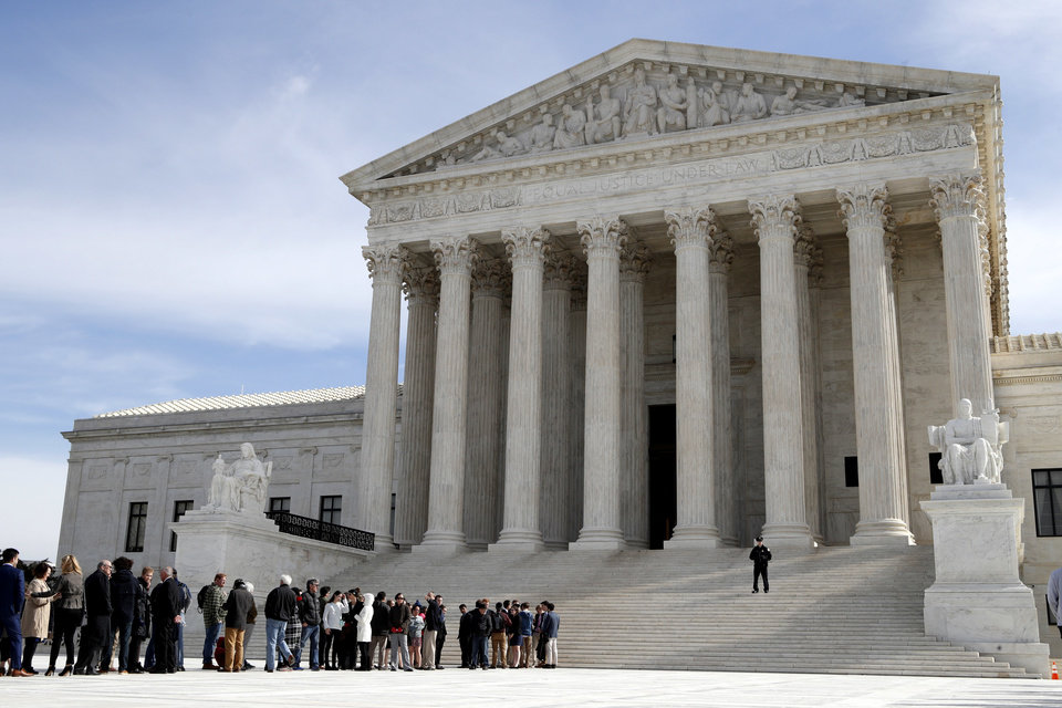 Photo - File: People stand in line to enter the Supreme Court, Wednesday, Feb. 28, 2018, in Washington. (AP Photo/Jacquelyn Martin)