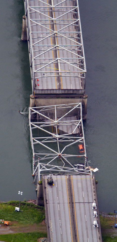 Photo - A collapsed section of the Interstate 5 bridge over the Skagit River is seen in an aerial view Friday, May 24, 2013, in Mt. Vernon, Wash. Part of the bridge collapsed Thursday evening, sending cars and people into the water when a an oversized truck hit the span, the Washington State Patrol chief said.  Washington Gov. Jay Inslee on Friday declared a state of emergency in three counties around the bridge, saying that the bridge collapse has caused extensive disruption, impacting the citizens and economy in Skagit, Snohomish and Whatcom Counties. (AP Photo/The Seattle Times, Mike Siegel)  MAGS OUT; NO SALES; SEATTLEPI.COM OUT; MANDATORY CREDIT