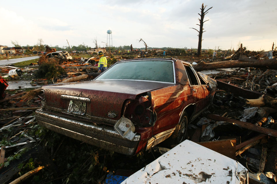 Photo - A car lays among the wreckage of a home flattened by a tornado in Smithville, Mississippi on Wednesday, April 27, 2011.(AP Photo/The Northeast Mississippi Daily Journal, C. Todd Sherman)