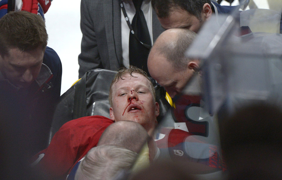 Photo - Montreal Canadiens' Lars Eller is taken off the ice following a hit by Ottawa Senators' Eric Gryba during the second period of Game 1 of an NHL hockey Stanley Cup playoffs first-round series in Montreal on Thursday, May 2, 2013. (AP Photo/The Canadian Press, Graham Hughes)