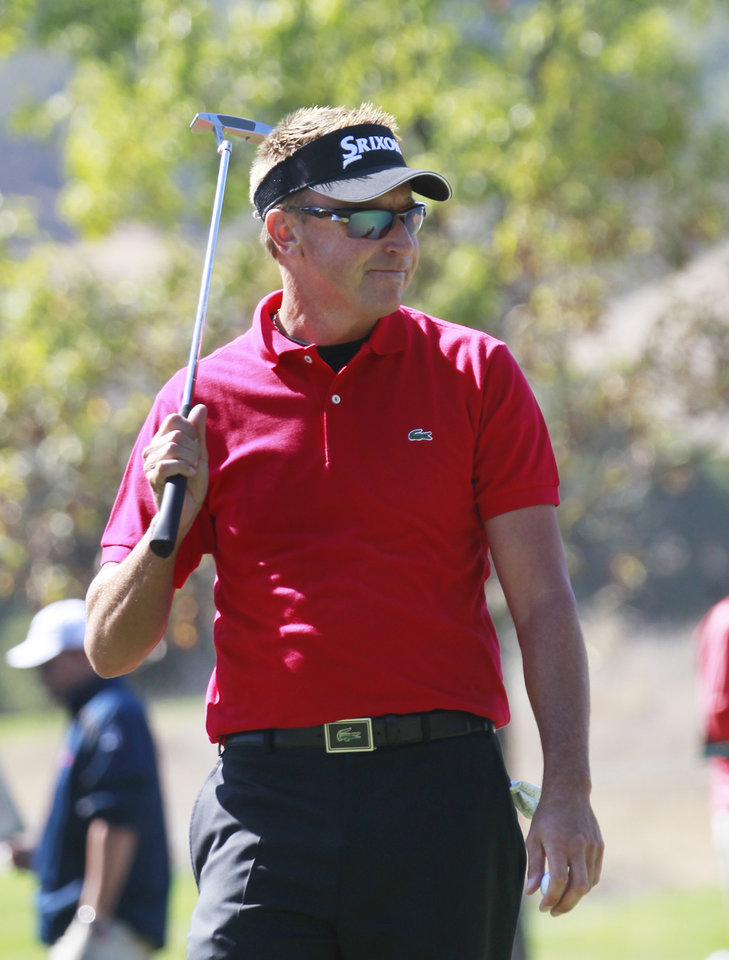Photo - Robert Allenby reacts to missing a putt on the 18th green during the first round of the Frys.com Open golf tournament at the CordeValle golf course in San Martin, Calif., on Thursday, Oct. 10, 2013. (AP Photo/San Jose Mercury News, (Patrick Tehan)  MAGS OUT; NO SALES