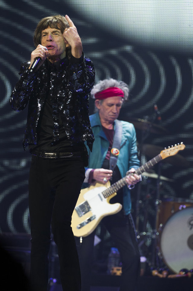 Photo - Mick Jagger, left, and Keith Richards of The Rolling Stones perform in concert on Saturday, Dec. 8, 2012 in New York. (Photo by Charles Sykes/Invision/AP)