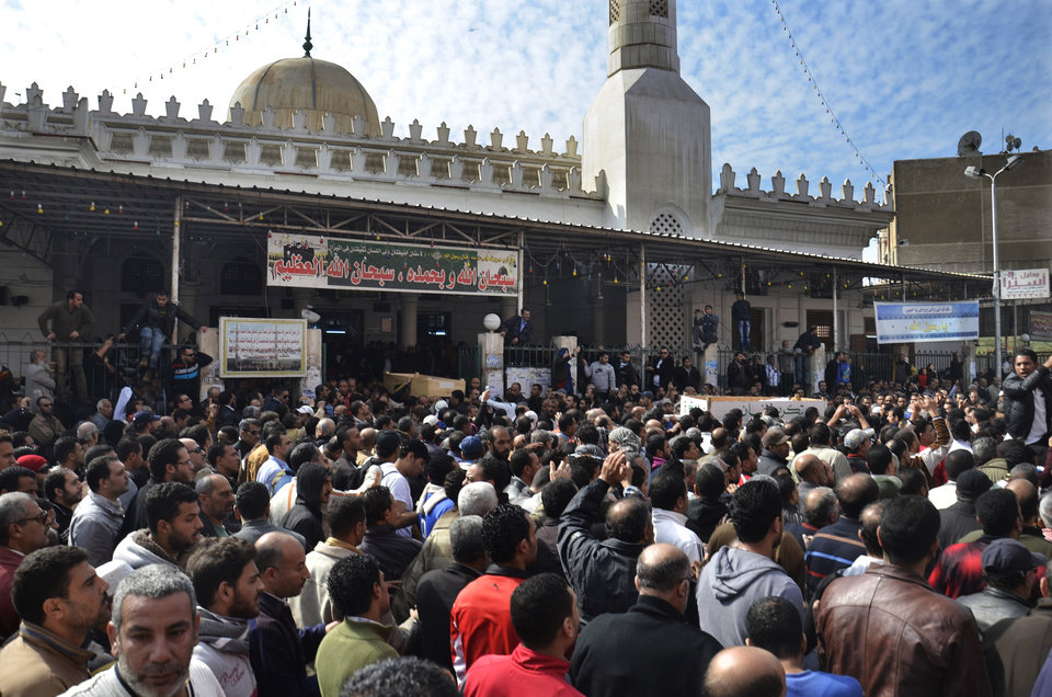 Photo - Egyptians attend the funeral of several victims of ongoing violence in Port Said, Egypt, Monday, Jan. 28, 2013. The worst violence in Egypt this weekend was in the Mediterranean coastal city of Port Said, where at least 44 people died in two days of clashes. The unrest was sparked on Saturday by a court conviction and death sentence for 21 defendants involved in a mass soccer riot in the city's main stadium on Feb. 1, 2012 that left 74 dead. (AP Photo)