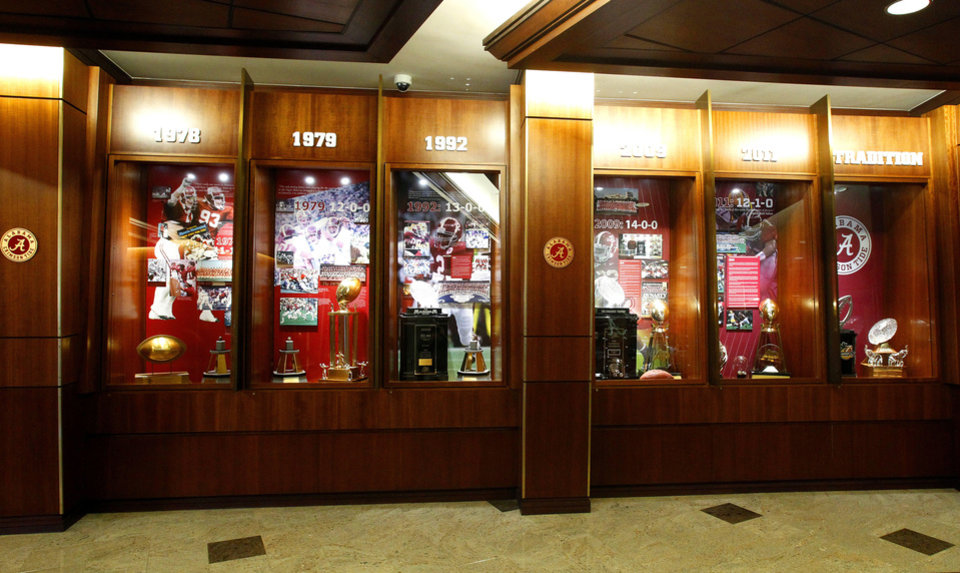 Photo - The Crimson Tide's trophies are on display at the Mal M. Moore Athletic Facility in Tuscaloosa, Ala.  AP Photo