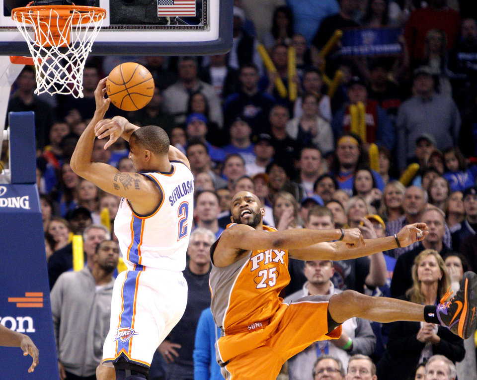 Oklahoma City's Thabo Sefolosha (2) and Phoenix's Vince Carter (25) fight for a rebound during the NBA game between the Oklahoma City Thunder and the Phoenix Suns, Sunday, March 6, 2011, the Oklahoma City Arena. Photo by Sarah Phipps, The Oklahoman.