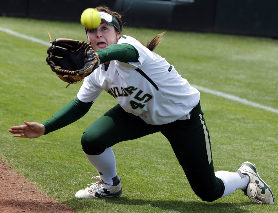 Baylor's Linsey Hays tries to catch a foul as the University of Oklahoma (OU) Sooners play the Baylor Bears in NCAA college softball at Marita Hines Field on Saturday, April 6, 2013  in Norman, Okla.  She missed.  Photo by Steve Sisney, The Oklahoman