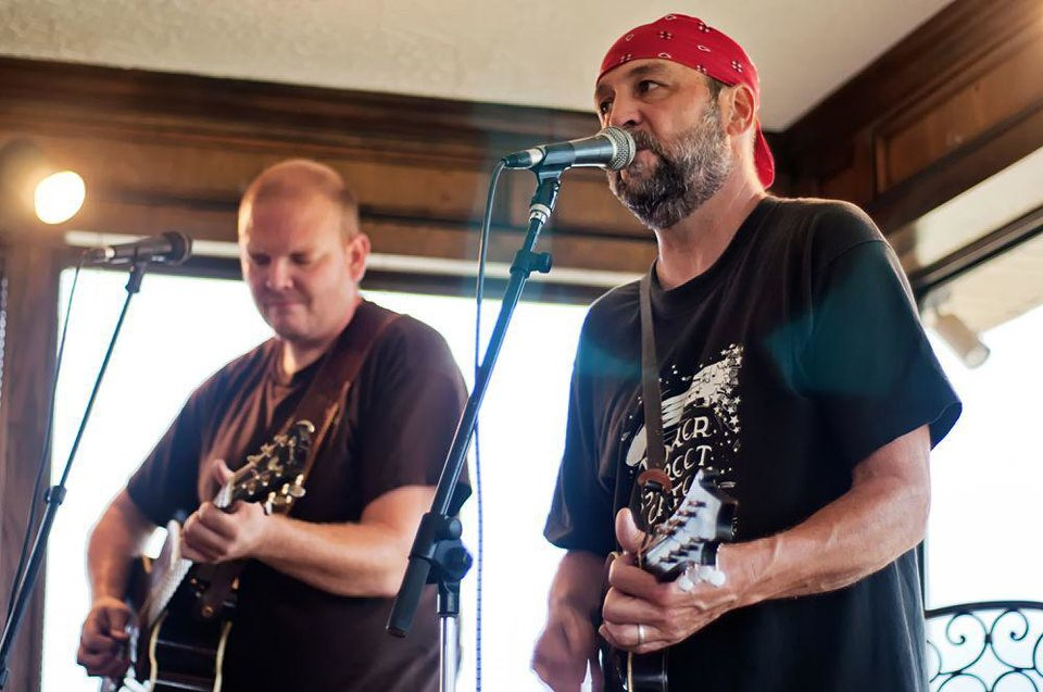 Bo Phillips, left, and John Cooper play during a recent show at Cushing Country Club. Cooper, a member of the Red Dirt Rangers, hosts the Third Thursday Concert Series at the country club. Photo by Stacey Lauren of C Sharp Studios - Cushing, OK <strong></strong>
