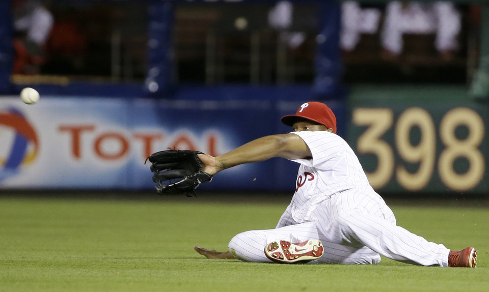 Philadelphia Phillies right fielder Delmon Young cannot catch a single by New York Mets' Juan Lagares in the eighth inning of a baseball game on Friday, June 21, 2013, in Philadelphia. New York won 4-3. (AP Photo/Matt Slocum)