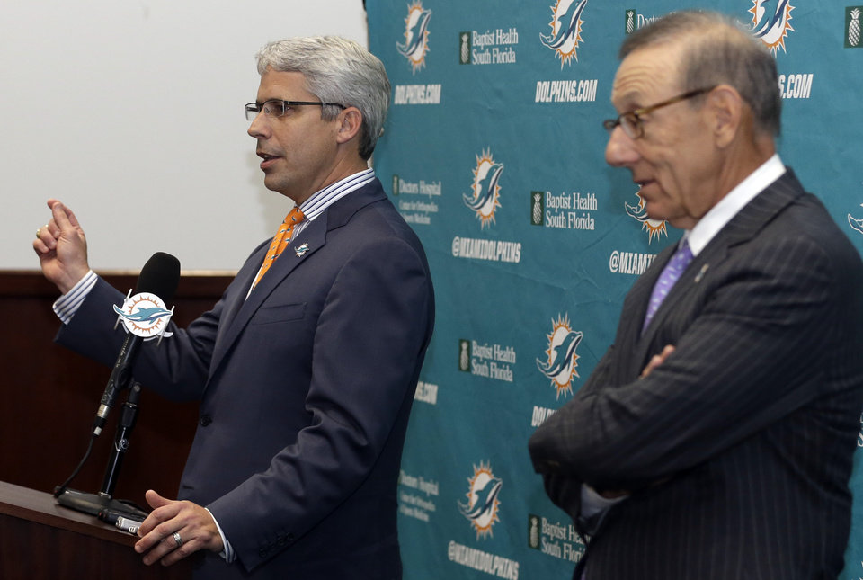 Photo - Dennis Hickey, left, the new general manager for the Miami Dolphins NFL football team, speaks after being introduced during a news conference by team owner Stephen Ross, right, Tuesday, Jan. 28, 2014, in Davie, Fla. (AP Photo/Lynne Sladky)