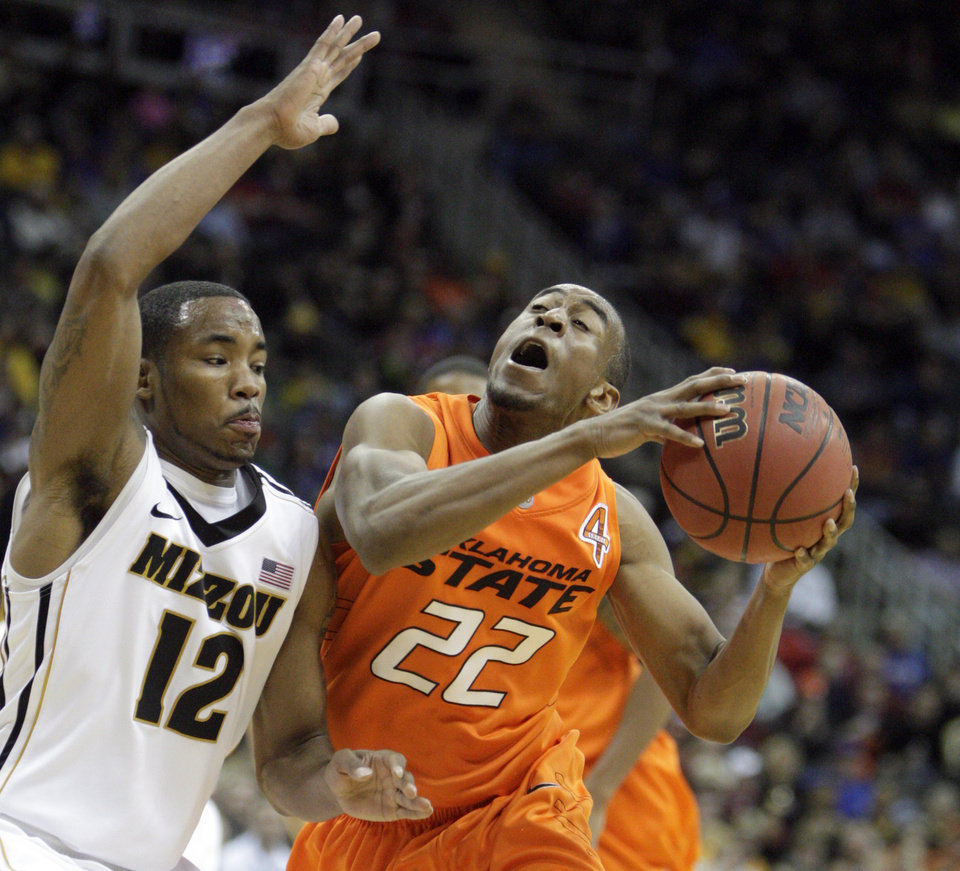 Oklahoma\'s Markel Brown (22) shoots as Missouri\'s Marcus Denmon (12) defends during the Big 12 tournament men\'s basketball game between the Oklahoma State Cowboys and Missouri Tigers the Sprint Center, Thursday, March 8, 2012. Photo by Sarah Phipps, The Oklahoman