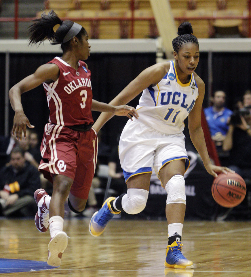 UCLA\'s Atonye Nyingifa (11) dribbles upcourt as Oklahoma\'s Aaryn Ellenberg defends during the first half of a second-round game in the women\'s NCAA college basketball tournament, Monday, March 25, 2013, in Columbus, Ohio. (AP Photo/Jay LaPrete) ORG XMIT: OHJL106