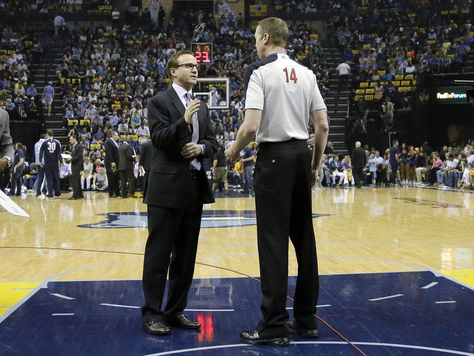 Oklahoma City Thunder head coach Scott Brooks talks with referee Ed Malloy (14) during a timeout in the first half of Game 6 of an opening-round NBA basketball playoff series against the Memphis Grizzlies, Thursday, May 1, 2014, in Memphis, Tenn. (AP Photo/Mark Humphrey)