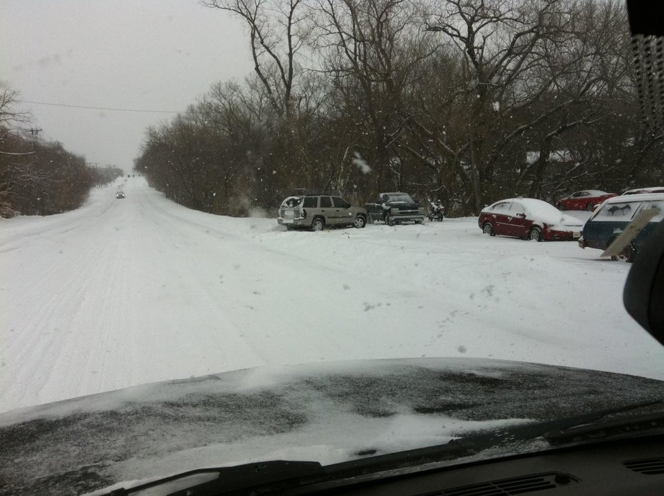 Photo - EDMOND -- Vehicles are stuck in the 200 block of E 15th Street in Edmond. PHOTO PROVIDED, EDMOND POLICE DEPARTMENT