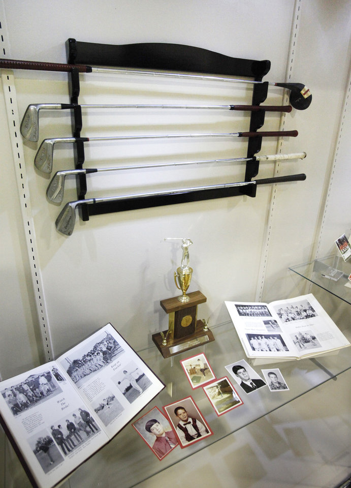 """Photo -  A set of Danny Edwards' clubs and a trophy he won in high school are on display at the Edmond Historical Society & Museum as part of the new exhibit, """"Fore — Looking Back at Golf in Edmond."""" Photo by David McDaniel, The Oklahoman      -"""