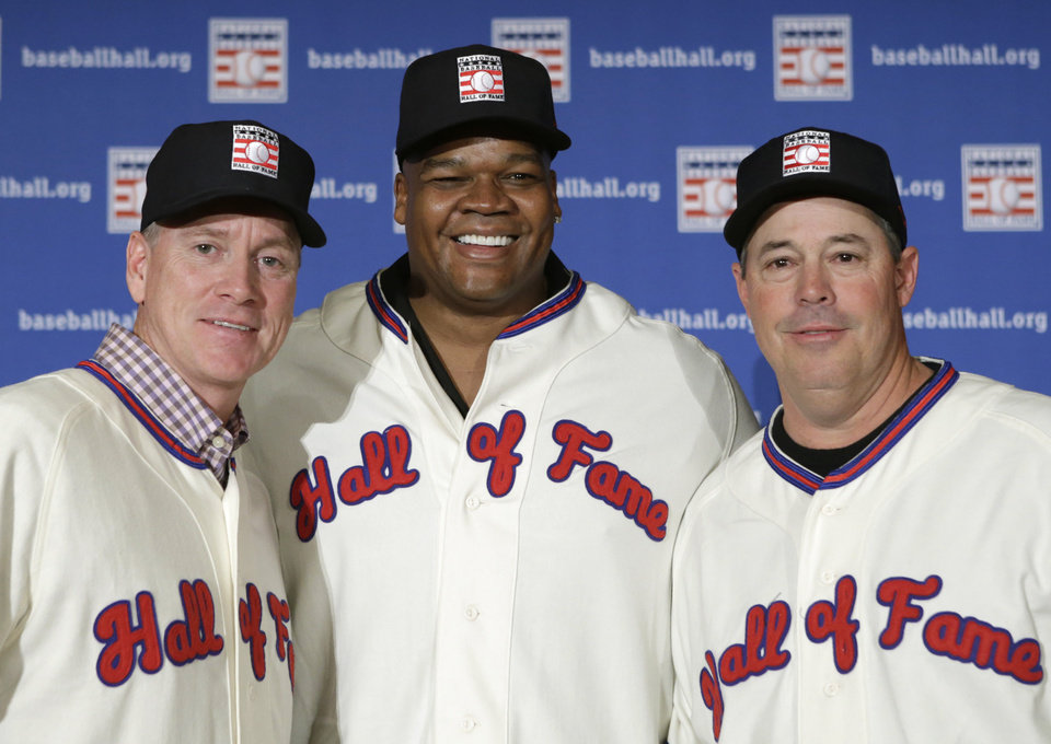 Photo - Former Atlanta Braves pitchers Tom Glavine, left and Greg Maddux, right, pose with Chicago White Sox slugger Frank Thomas after a press conference announcing their election to the 2014 Baseball Hall of Fame class, Thursday, Jan. 9, 2014, in New York. The trio will be inducted into the Hall of Fame in Cooperstown, N.Y., in July. (AP Photo/Kathy Willens)