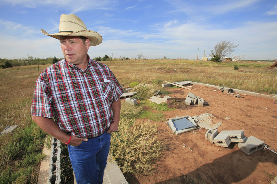 HOUSE / TORNADO RECOVERY: Derrick Butler looks over the foundation of his home near Cashion, Wednesday , October 3, 2011.   Butler lost his home and most of the things he owned in the May 24, 2011 tornado near Cashion. Photo by David McDaniel, The Oklahoman  ORG XMIT: KOD