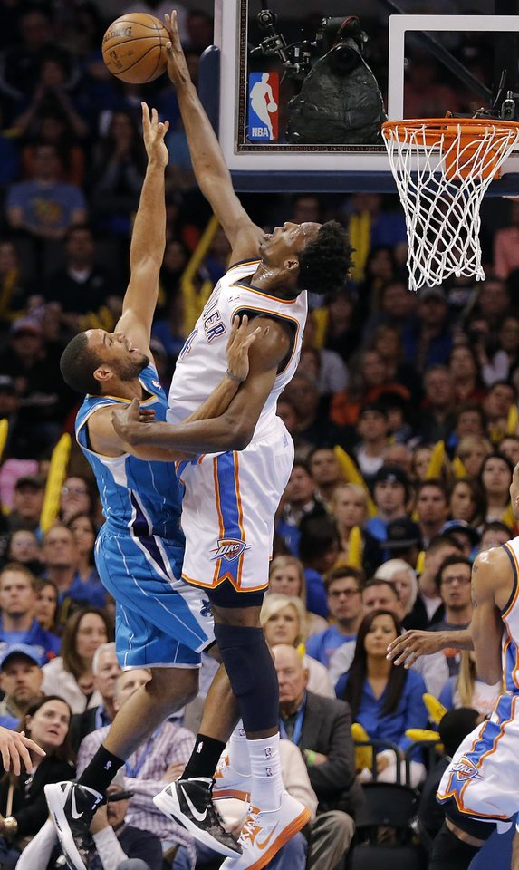 Oklahoma City Thunder\'s Hasheem Thabeet (34) blocks a shot by New Orleans Hornets\' Xavier Henry (4) during the NBA basketball game between the Oklahoma City Thunder and the New Orleans Hornets at the Chesapeake Energy Arena on Wednesday, Feb. 27, 2013, in Oklahoma City, Okla. Photo by Chris Landsberger, The Oklahoman