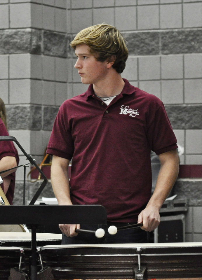 Photo -    Drew O'Connell, Edmond Memorial High School senior, plays the kettle drum in the wind ensemble during the Swine Week concert. Photo by M. Tim Blake, for The Oklahoman   M. Tim Blake