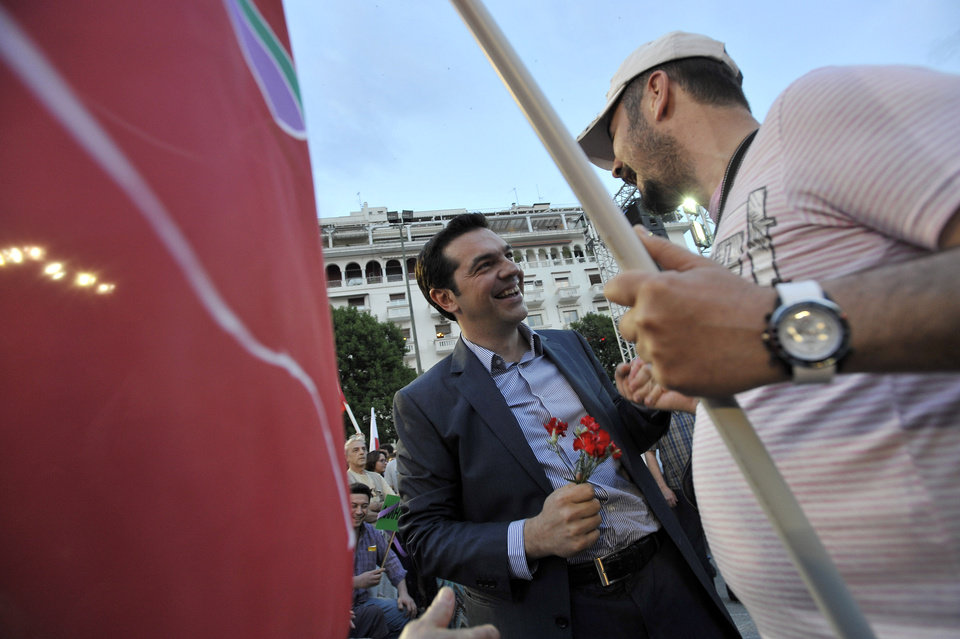 Photo -   Greek leader of Coalition of the Radical Left party (SYRIZA) Alexis Tsipras, left, shakes hands with a supporter in the northern Greek port city of Thessaloniki, Friday, May 4, 2012. The country will hold national elections this Sunday, with opinion polls indicating no party will win enough of a majority to form a government without seeking the backing of another party to form a coalition. (AP Photo/Nikolas Giakoumidis)