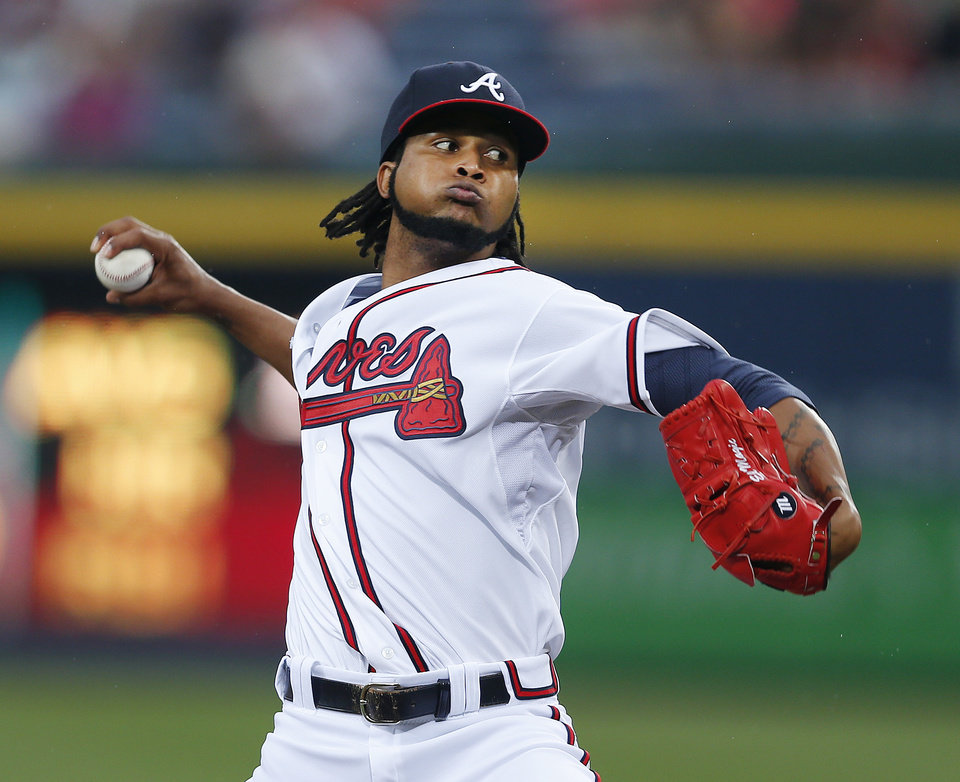 Photo - Atlanta Braves starting pitcher Ervin Santana works in the first inning of a baseball game against the Philadelphia Phillies  in Atlanta, Friday, July 18, 2014. (AP Photo/John Bazemore)