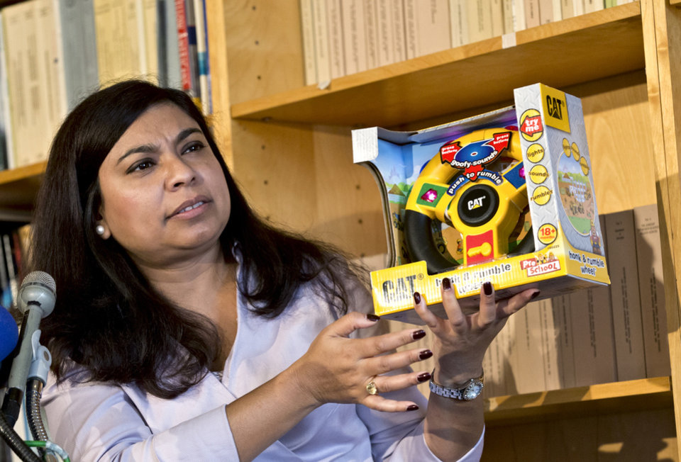 Nasima Hossain, a U.S. Public Interest Research Group (PIRG) advocate holds a honk and rumble wheel, considered a loud toy, during a PIRG news conference in Washington, Tuesday, Nov. 20, 2012, where it released its 27th annual Trouble in Toyland report on hazardous toys. (AP Photo/J. Scott Applewhite)