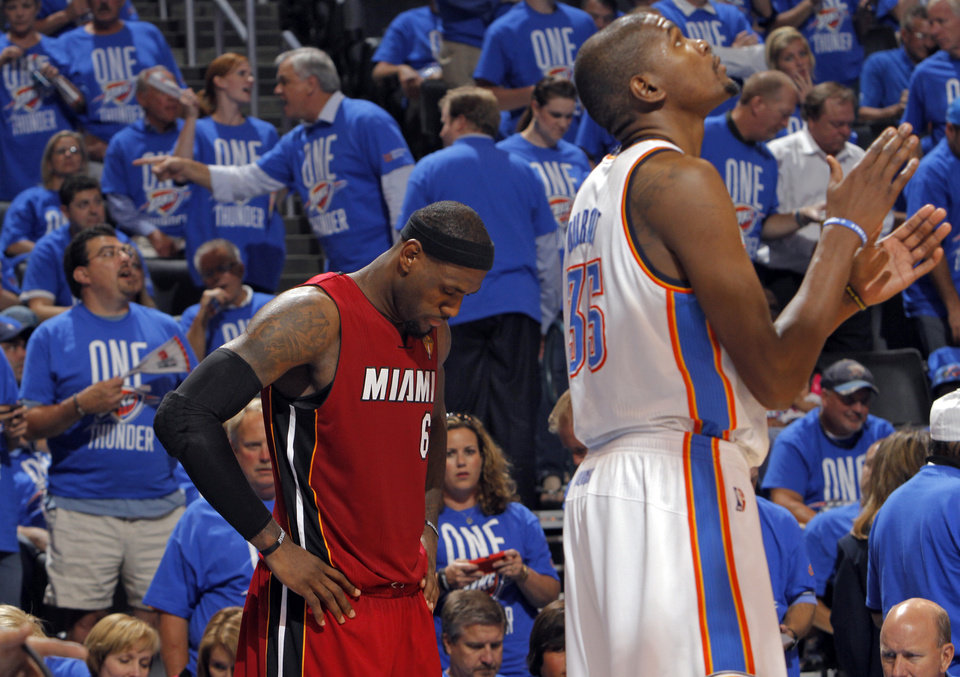Miami's LeBron James (6) lowers his head as he and Oklahoma City's Kevin Durant (35) wait during a timeout during Game 1 of the NBA Finals between the Oklahoma City Thunder and the Miami Heat at Chesapeake Energy Arena in Oklahoma City, Tuesday, June 12, 2012. Photo by Chris Landsberger, The Oklahoman